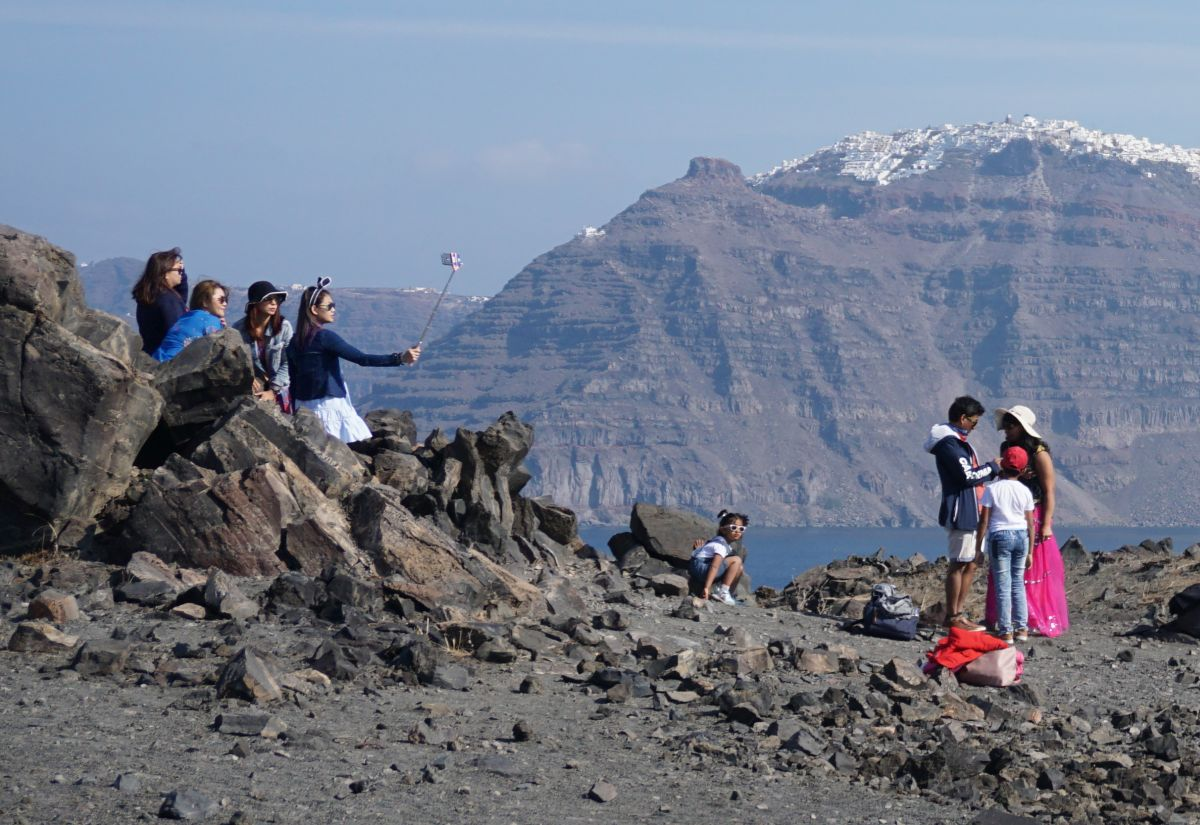 Tourists on Santorini's volcano. Photo © GTP