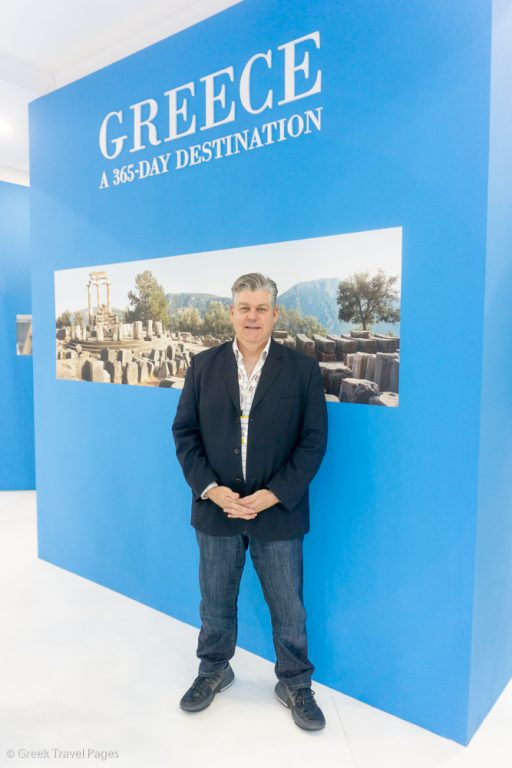 WFTA Executive Director Erik Wolf at the Greek stand during WTM London 2018.