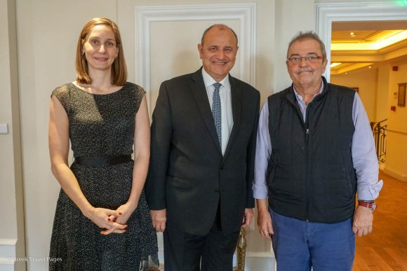 Lampsa Hellenic Hotels Senior Executive Director Chloe Laskaridis and CEO Tasos Homenidis (R) with the general manager of Hotel Grande Bretagne & King George, Tim Ananiadis, during a recent Christmas event at the King George Hotel in Athens.