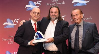 Seajet's Marios (center) and Panagiotis Iliopoulos receive the Lloyd's List Award by Kyriakos Mitsotakis, Commercial Director of Award Sponsor Five Oceans Salvage.