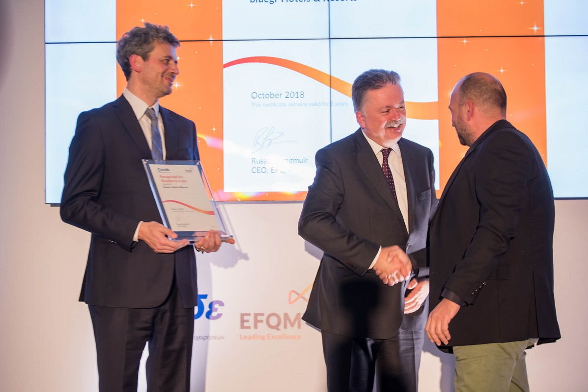 Bluegr Hotels & Resorts IT Manager Vasilis Barbas received the award from EEDE President Grigoris Tapinos; EFQM Chief Operating Officer Gianluca Mule and EEDE General Manager Anastasios Rodopoulos.