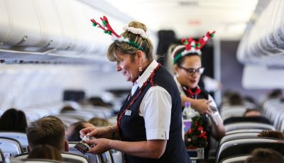 LAPLAND, FINLAND: Andrea Hatfield (Cabin Crew) gets into the Christmas spirit onboard a special charter to Lapland from London Gatwick on 07 December 2015