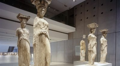 The Caryatids at the Acropolis Museum. Photo Source: Acropolis Museum