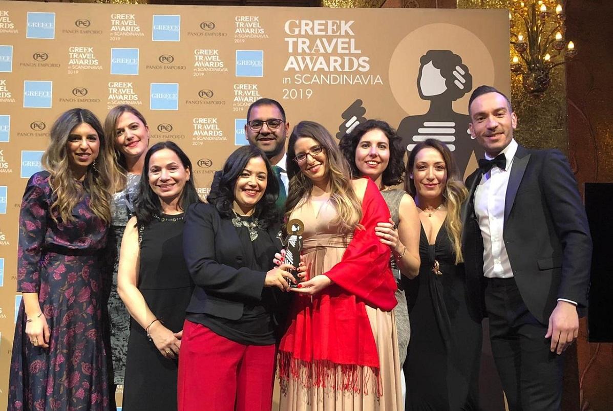 "The ""Kallichoron"" team at the Greek Travel Awards 2019. The hotel's founders Carolina Alkalai and Maria Mavroudi are holding the award (center)."