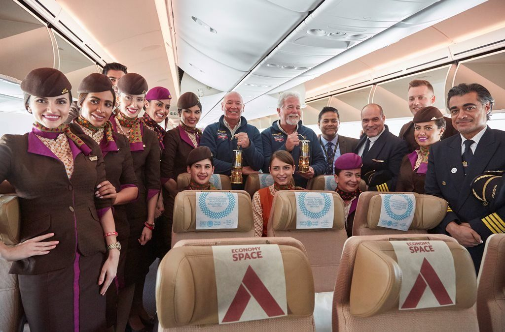 Guardians of the World Games Flame of Hope with captains and cabin crew on board Etihad Airways.