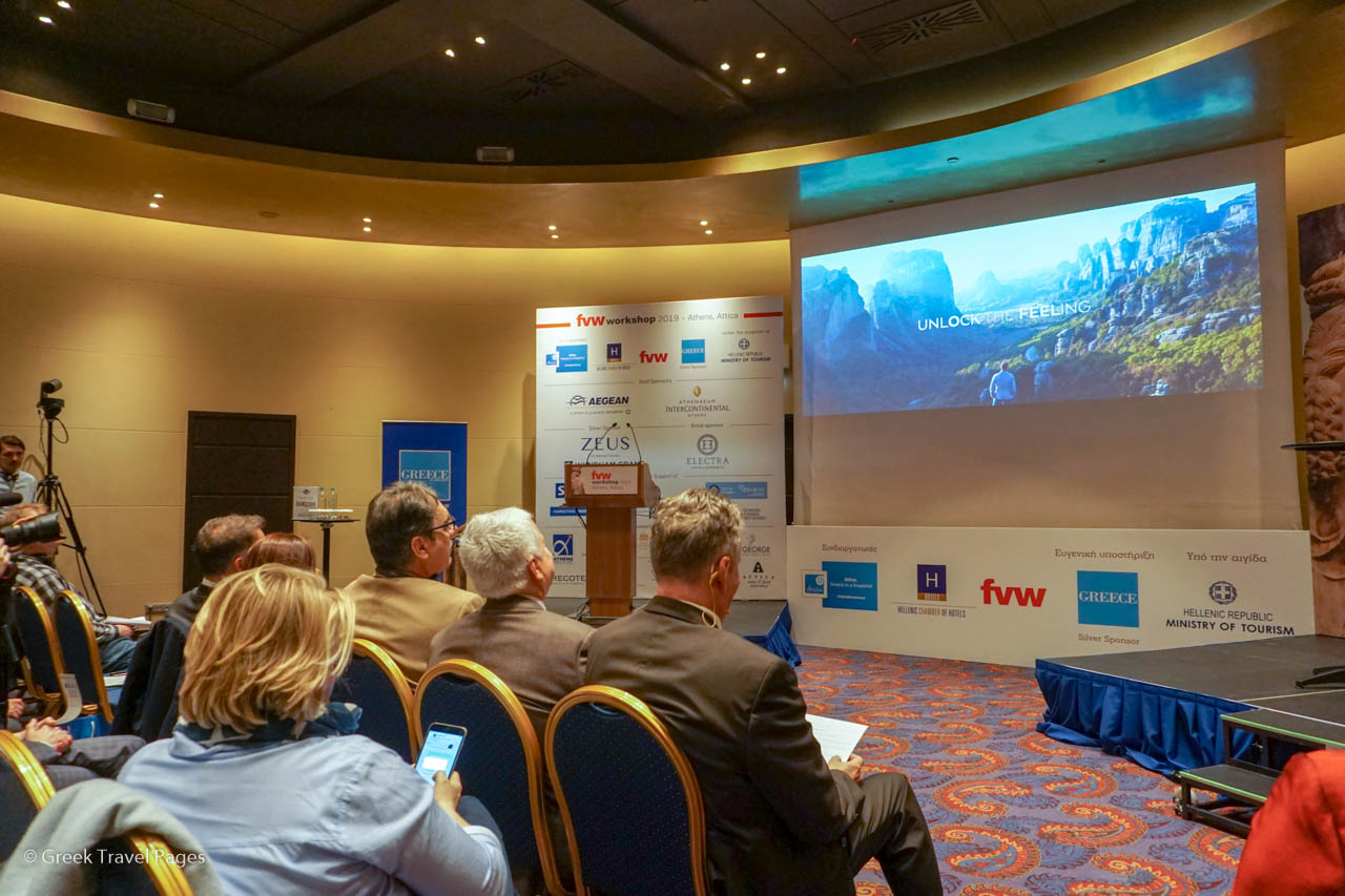 "The audience of the ""FVW workshop Athens-Attica 2019"" watching a screening of Marketing Greece's tourism video ""Oh My Greece 