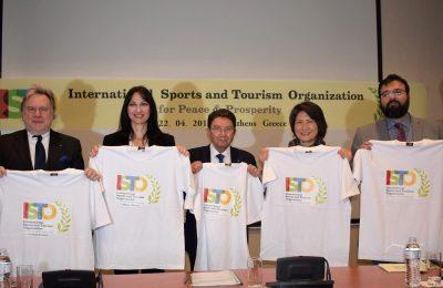 George Katrougalos, Elena Kountoura, Young-shim Dho and Taleb Rifai present the t-shirts with the logo of the ISTO P&P.
