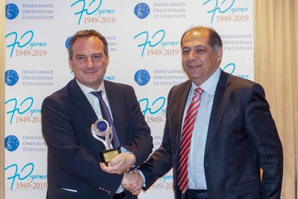 The award for Tilemachos Grigoriadis was received by his son Nikos Grigoriadis from Hellenic Hoteliers Federation Secretary General Kostas Hatzikonstantinou.