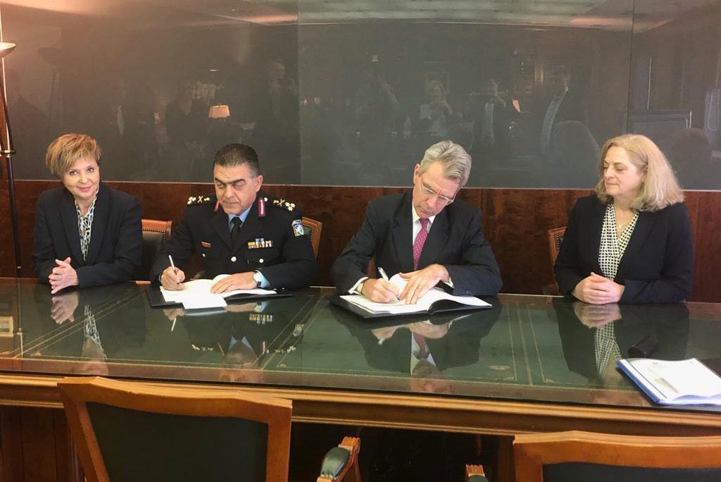 U.S. Ambassador Pyatt signing the memorandum of cooperation between the United States and Greece on implementing Greece's Passenger Name Record (PNR) law. Citizens Protection Minister Olga Gerovasili (L) attended the signing.