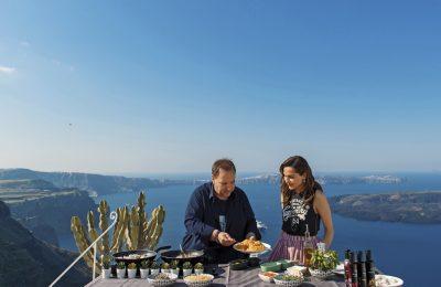 Greek Chef Vangelis Driskas and singer Despina Vandi prepare a local dish of Santorini at Dreams Luxury Suites.