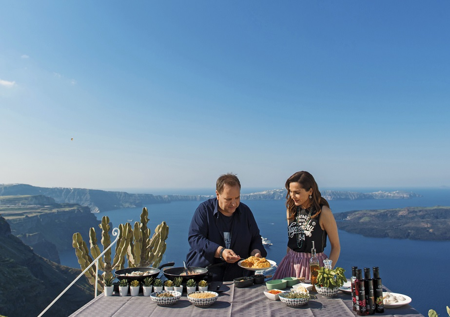 Greek Chef Vangelis Driskas and singer Despina Vandi prepare a local dish of Santorini at Dreams Luxury Suites.