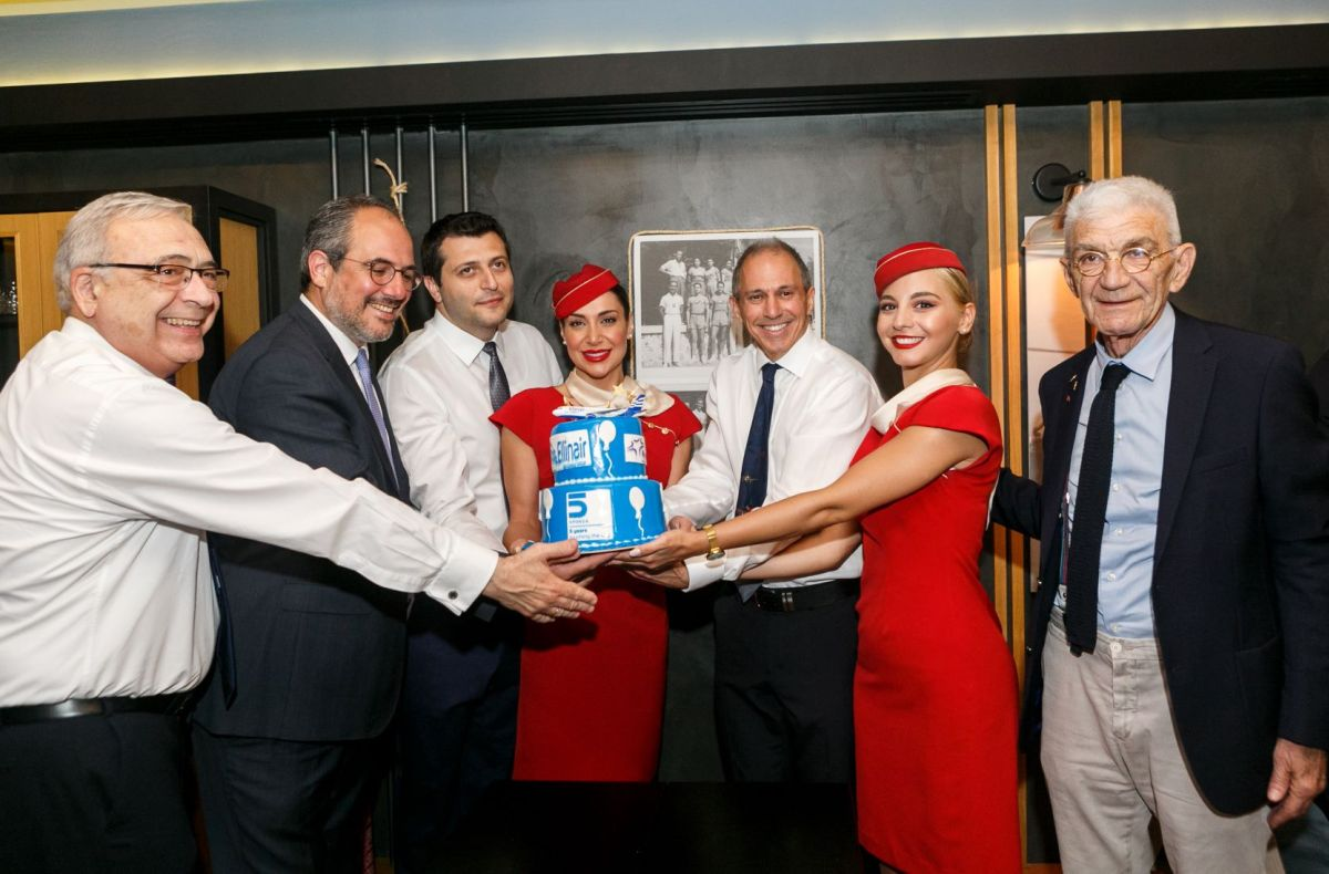 Ellinair Commercial Director Stavros Daliakas, Fraport Greece Executive Director Commercial & Business Development George Vilos, Ellinair President Ioannis Mouzenidis, Ellinair CEO Thanos Paschalis, Thessaloniki's former mayor Yannis Boutaris and the airline's flight attendants.
