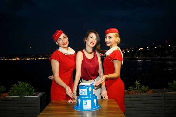 Ellinair Senior Marketer Natassa Tzikou with the airline's flight attendants.