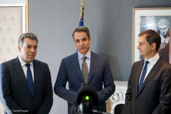 Greek Prime Minister Kyriakos Mitsotakis (center) with Deputy Tourism Minister Manos Konsolas (left) and Tourism Minister Harry Theoharis, during his visit to the Tourism Ministry in Athens on Thursday.