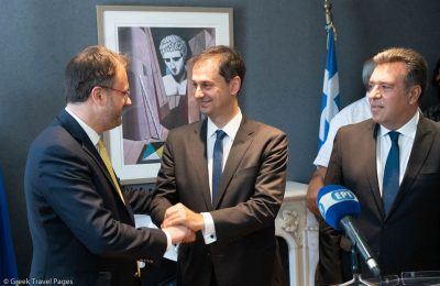 New Greek Tourism Minister Harry Theoharis (right) congratulating Outgoing Tourism Minister Thanasis Theocharopoulos for a