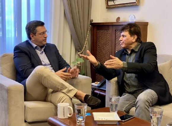 Apostolos Tzitzikostas, governor of the region of Central Macedonia and Nilesh Malhotra, Indian film actor/director.