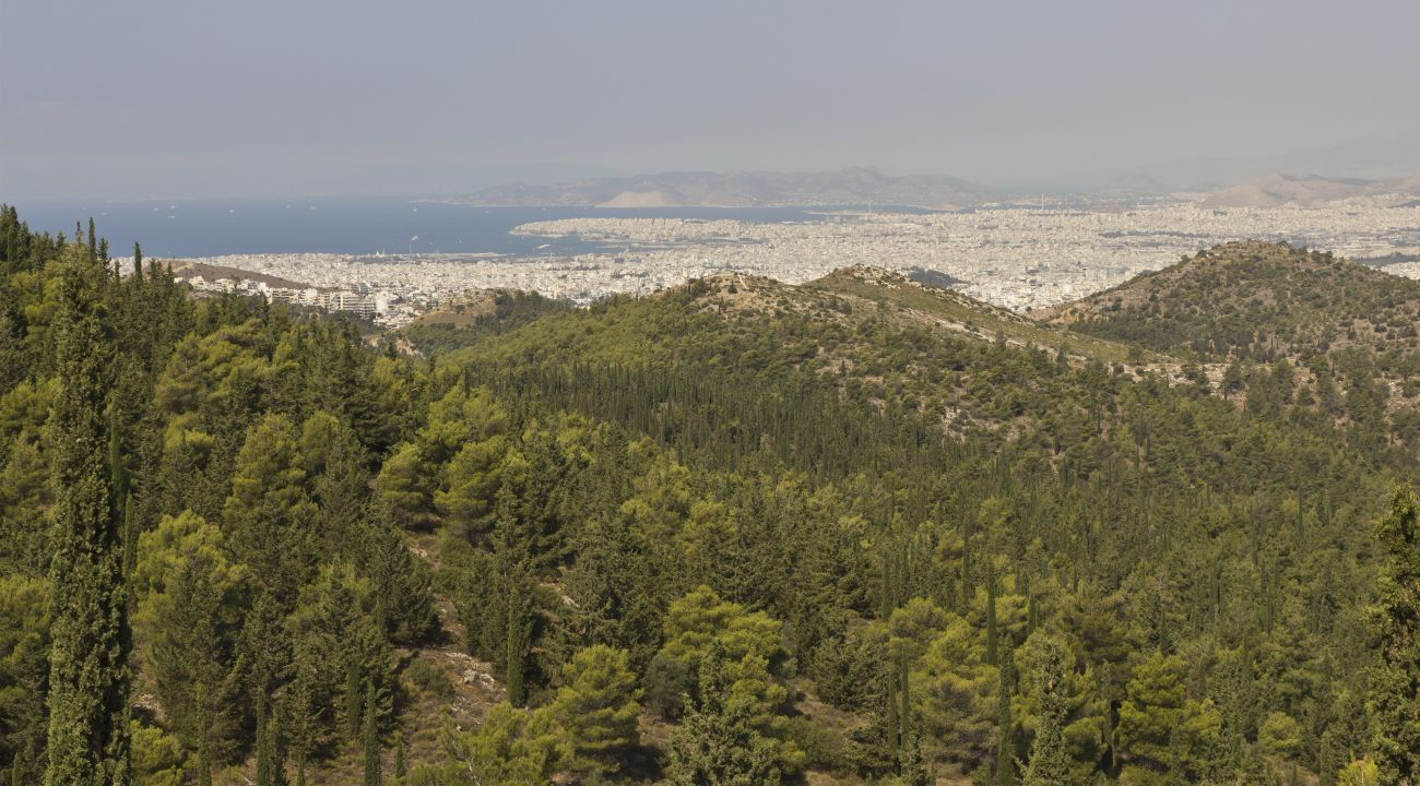 View from Kaisariani Hill looking towards Athens, with Salamis visible in the background. Photo by A.Savin (Wikimedia Commons · WikiPhotoSpace)