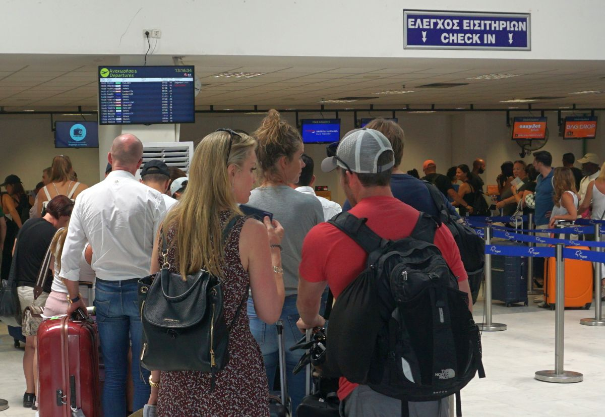 Travelers at Mykonos Airport. Photo © GTP