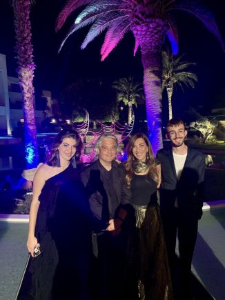 Rodos Palace's Mary Kambourakis (second from right) with artist Nikos George Papoutsidis (third from right).