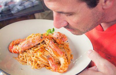 Man eating shrimp spaghetti