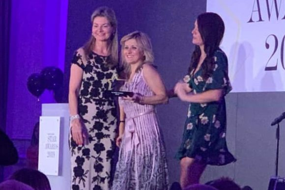 The head of GNTO UK & Ireland Emy Anagnostopoulou (center) received the two Travel Bulletin Star Awards.