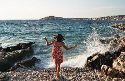 Girl on a rocky beach