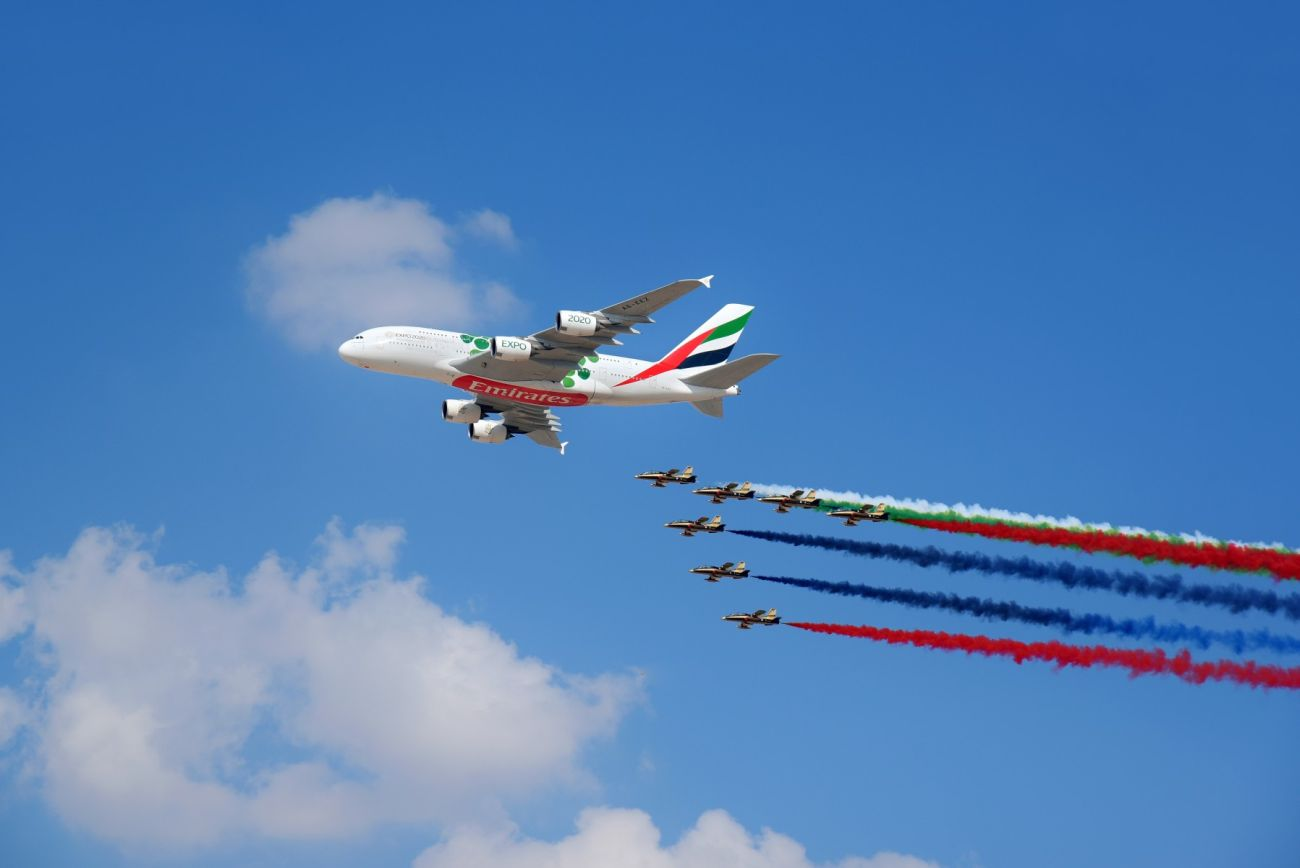 The Emirates A380 marks the opening of the Dubai Airshow with unprecedented flypast accompanied by 26 Military and Air Display Aircraft.