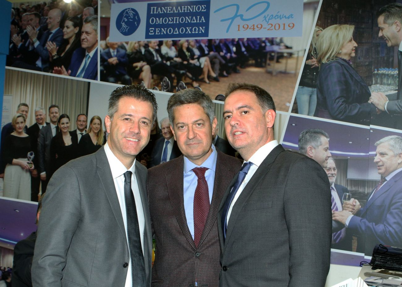Hellenic Hoteliers Federation's president Grigoris Tasios and 1st VP, Manolis Giannoulis, with Hellenic Chamber of Hotels President Alexandros Vassilikos.