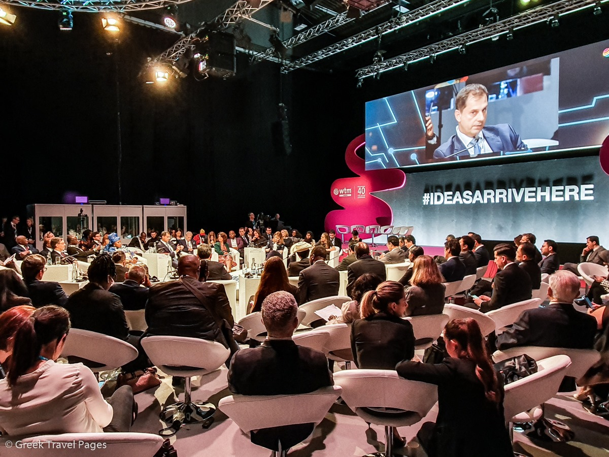 Greek Tourism Minister Harry Theoharis (shown on screen) was among the tourism leaders that attended the UNWTO and WTM Ministers Summit.