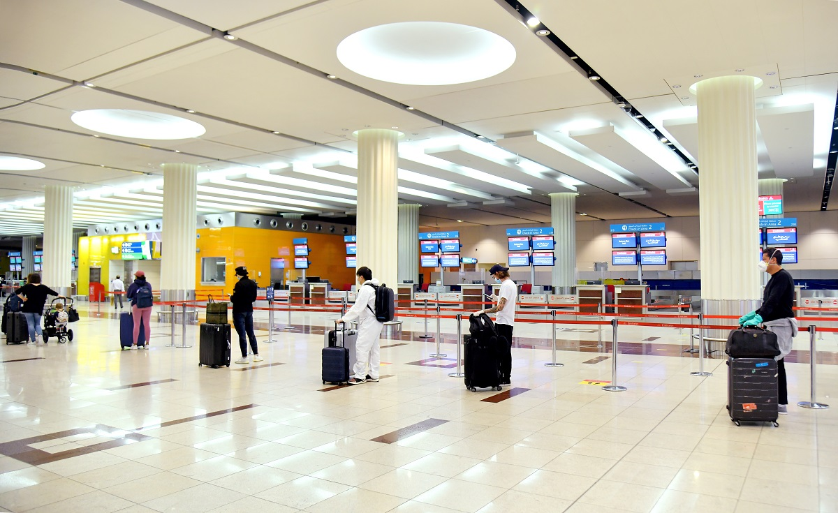 Emirates implements physical distancing protocols at check-in.
