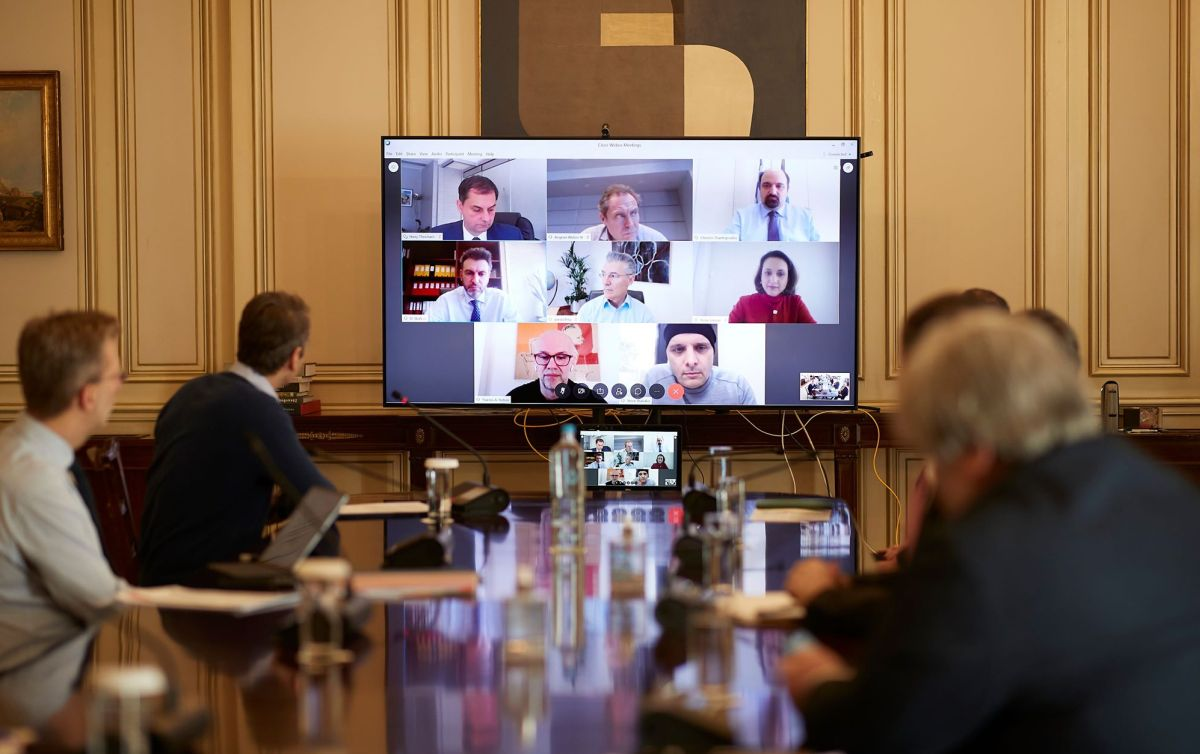 Greek Prime Minister Kyriakos Mitsotakis (left) during a video conference with tourism stakeholders on Thursday.