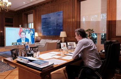 Greek PM Kyriakos Mitsotakis discussing with Austrian Chancellor Sebastian Kurz during a videoconference held between world leaders on April 24. Photo source: primeminister.gr