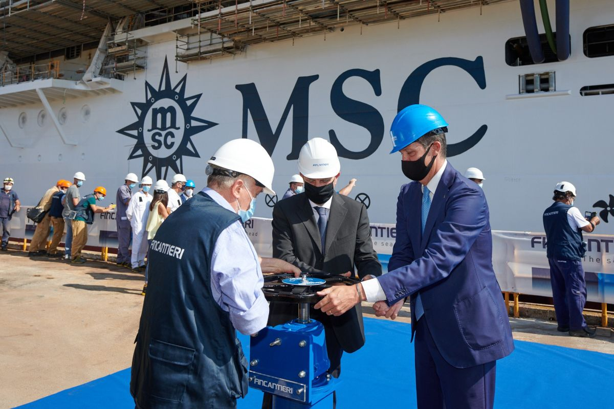 MSC Cruises and Fincantieri representatives together open the valves at the MSC Seashore float out ceremony.