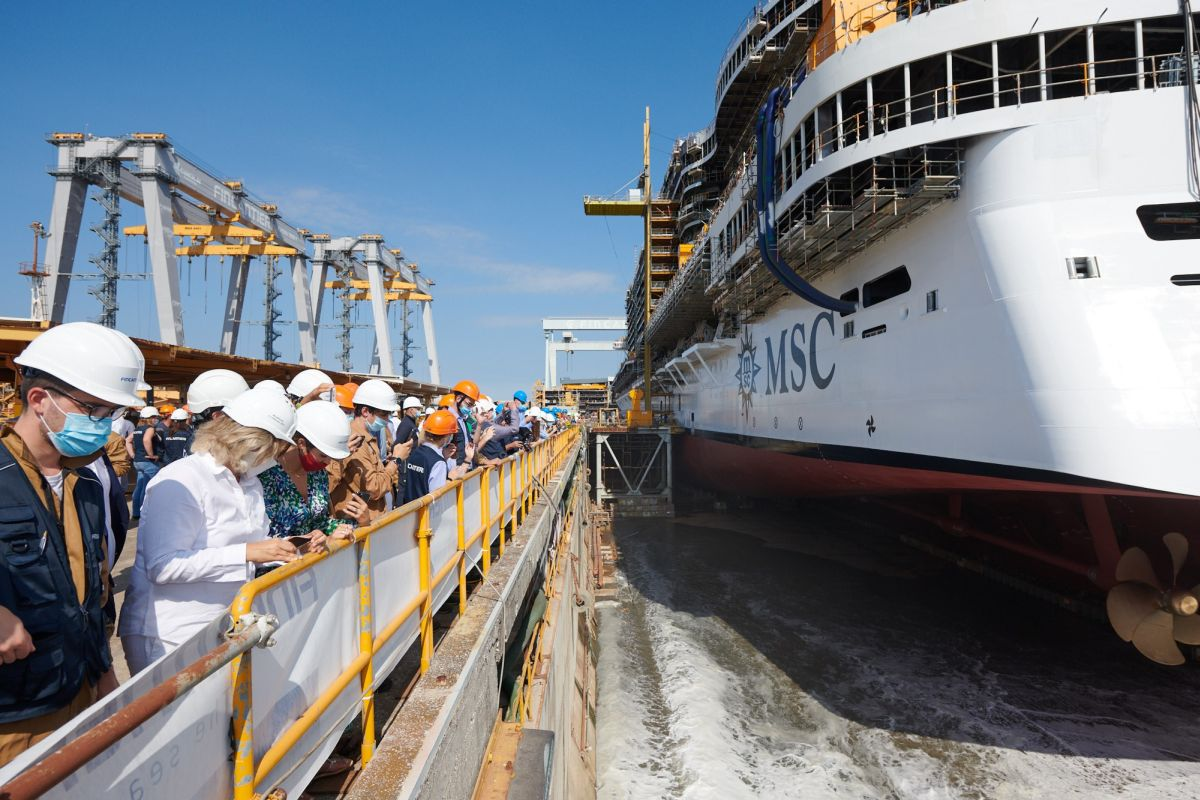 Water enters the dry dock to float MSC Seashore for the first time.
