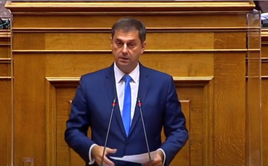 Greek Tourism Minister Harry Theoharis speaking in parliament.