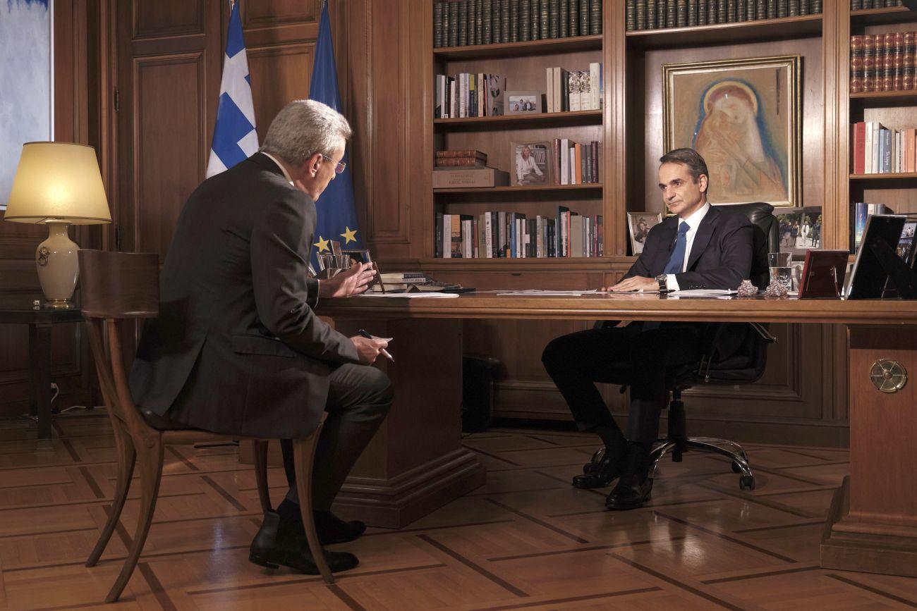 Greek Prime Minister Kyriakos Mitsotakis being interviewed by journalist Nikos Hatzinikolaou. Photo source: @PrimeministerGR