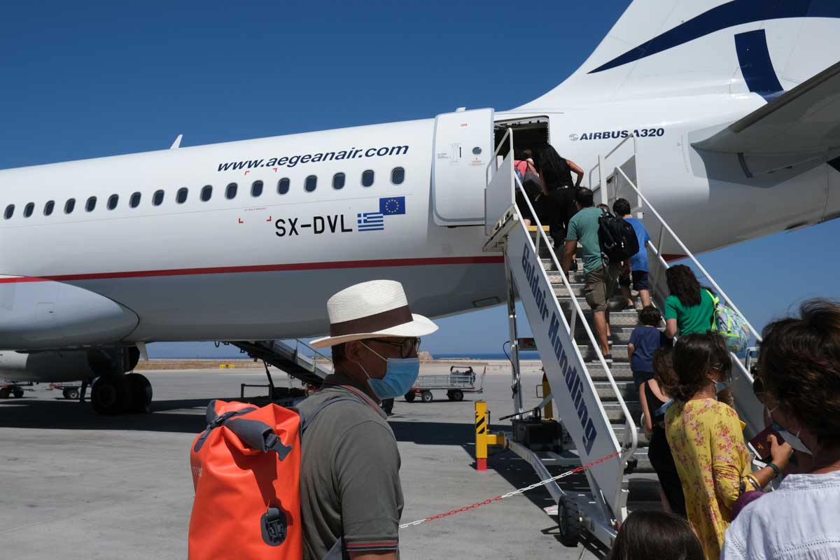 Airline passengers boarding on airplane