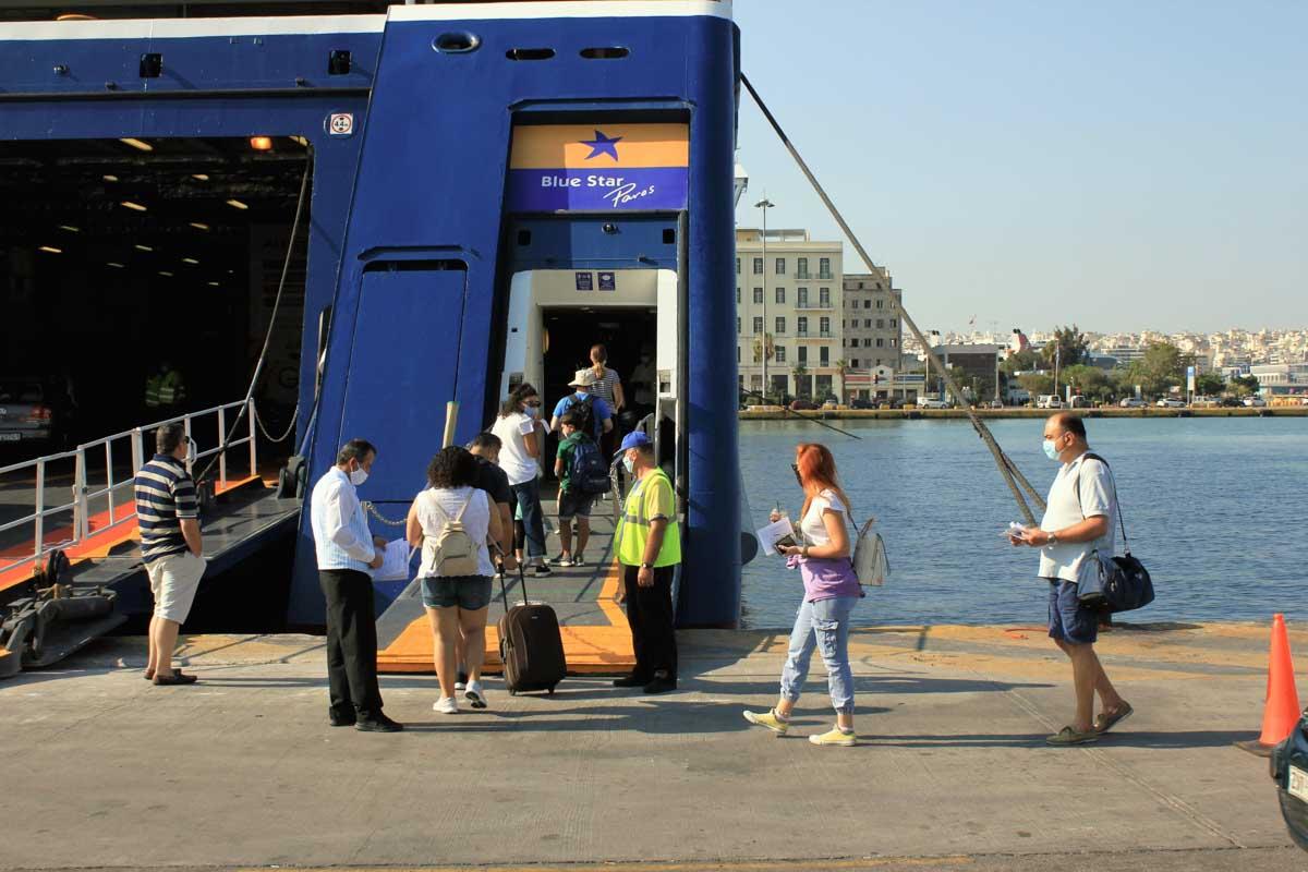 Greece, Piraeus, August 1 2020 - Passengers embarking on a ferry boat with Greek islands as destination. Photo: Theastock / Shutterstock.com