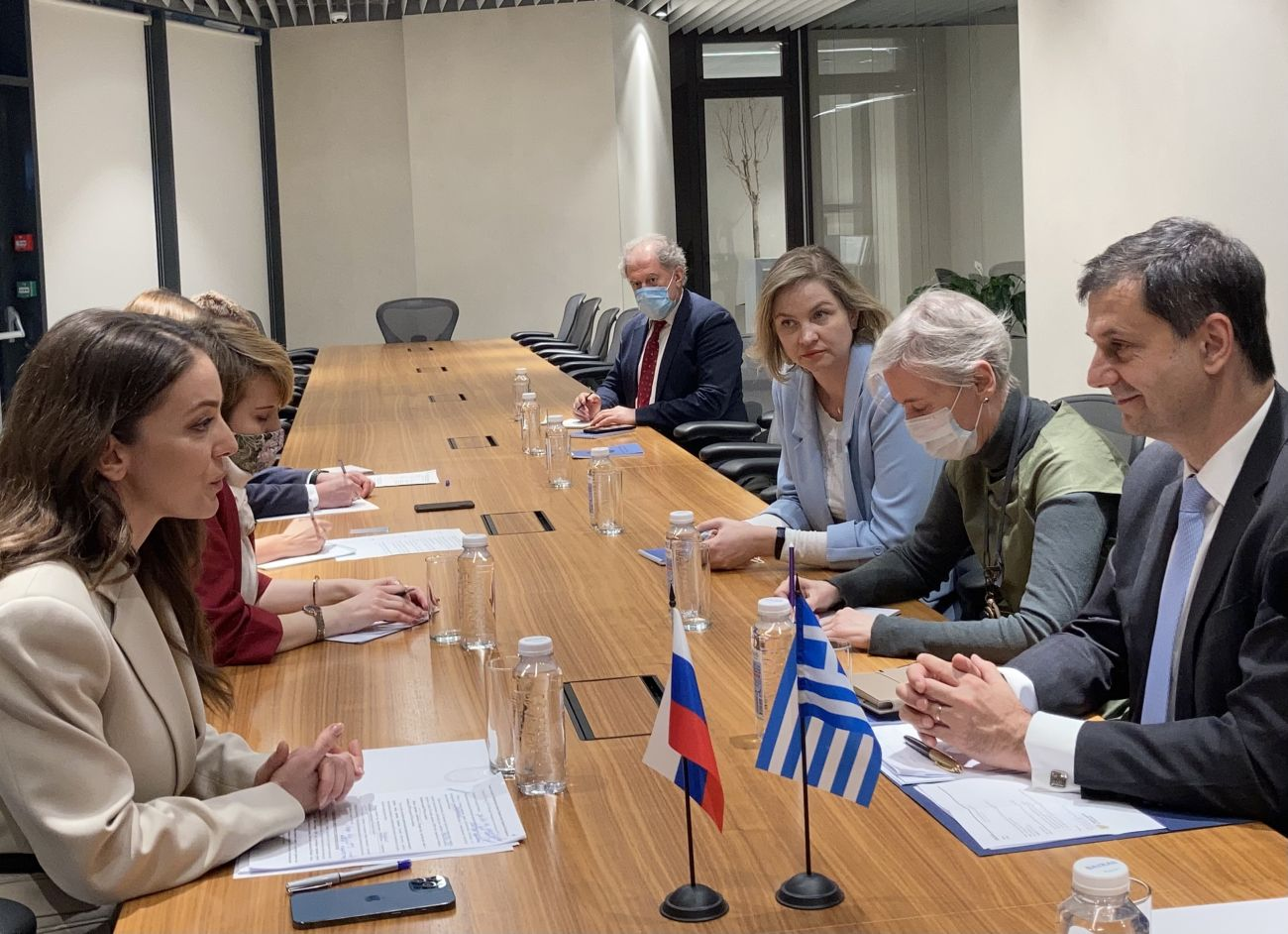 Greek Tourism Minister Harry Theoharis in discussion with the head of Russia's Federal Agency for Tourism, Zarina Valerievna Doguzova.