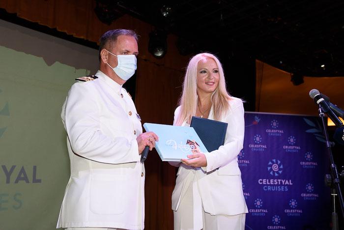 Celestyal Crystal's Captain Nikolaos Vassilios receiving an honorary plaque from Port of Lavrio Chairman Ioanna Koulouvraki.