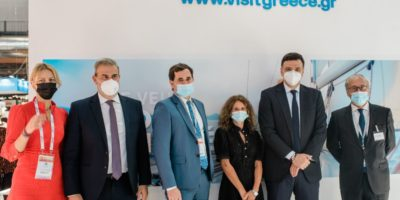 Greek Tourism Minister Vassilis Kikilias (second from right) and Greek National Tourism Organization Secretary General Dimitris Fragakis (second from left) with representatives of Air France at the Greek stand at the IFTM Top Resa expo in Paris.