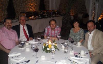 Kiriakos Kiriakopoulos, former director of the Ios health center; Yiorgos Poussaios, Ios Mayor; John Carr, Times correspondent; Athena Carr; and Nasos Dimitropoulos, attorney-at-law attend a dinner that followed the presentation of Ios Island.