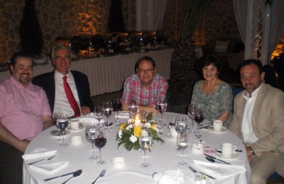 Kiriakos Kiriakopoulos, former director of the Ios health center; Yiorgos Poussaios, Ios Mayor; John Carr, Times correspondent; Athena Carr; and Nasos Dimitropoulos, attorney-at-law attend a dinner that followed the presentation of Ios Island.