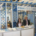 "At the Pelion stand: Lambrini Pantou, representative of the Mouressi Municipality in Pelion, and Georgios Zafiris, vice president of the Hotels' Association of Magnesia. The region's promotional campaign to the German market, entitled ""Direct your own escape to Pelion,"" borrowed a little from the success of the film ""Mamma Mia,"" as scenes were shot in Mouressi."