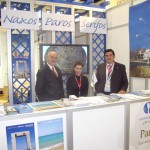 "Paros representatives Giorgos Kallergis and Dimitris Petropoulos; and Naxos Municipality representative Eftihia Margariti (center) at the Paros section of the Cyclades island group stand. ""A study has been implemented with the GNTO for the creation of nine different walking paths throughout Paros,"" said Mr. Petropoulos."