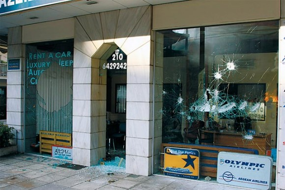 A travel office in downtown Athens damaged during the difficult weeks of December. Such images circulated globally and tarnished the image of the Greek capital. Photo: Christos Mathioudakis