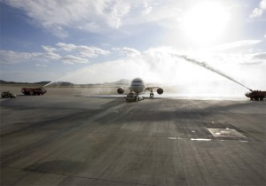 The first Air China flight from Athens to Beijing departs Athens International Airport, as tradition dictates, under the water arch.