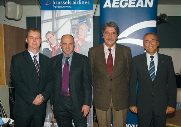 "Brussels Airlines Vice President of Communications, Geert Sciot (left), referred to Lufthansa which in September 2008 bought 45 percent of the Belgian airline: ""Once approved by the European Commission, Lufthansa will be able to buy Brussels Airlines as of 2011 and onwards."" To the right are: Giovanni Matassa, commercial director of Aegean Airlines; John Platanias, sales manager of Brussels Airlines in Greece; and Dimitris Gerogiannis, CEO of Aegean Airlines."