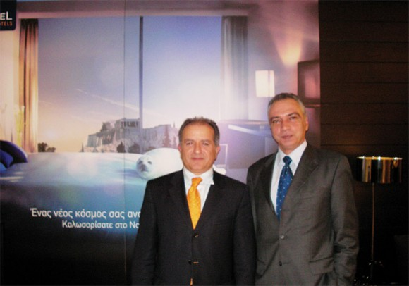 Evripides Tzikas, general manager of Novotel Athenes and George Stavrou, country commercial director for the Accor group in Greece, at the refurbished lobby of the hotel.