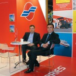 Sales country manager of Blue Star/Superfast Ferries, George Panayiotides (right), with a visitor to the ferry company's stand.